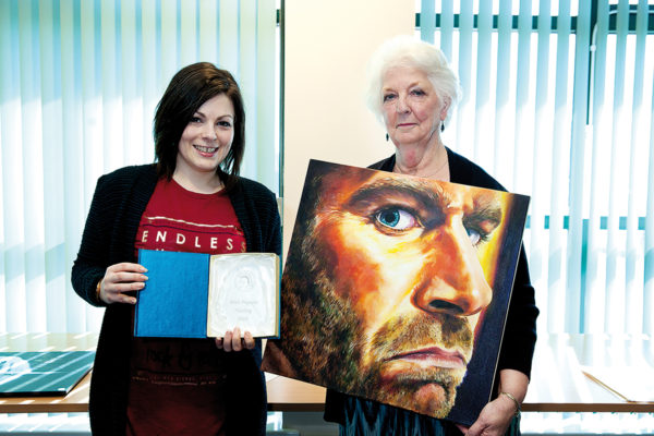 Becky Harrison and Kate Brogden with winning painting Angry Gary